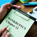 Man reads bankruptcy chapter 13 law in the office.